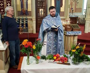 Fr. Ignatius blessing fruit for the Feast of Transfiguration